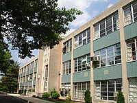 """""""Archbishop Wood Catholic High School"""" by Tomshakely. Public Domain via Commons."""